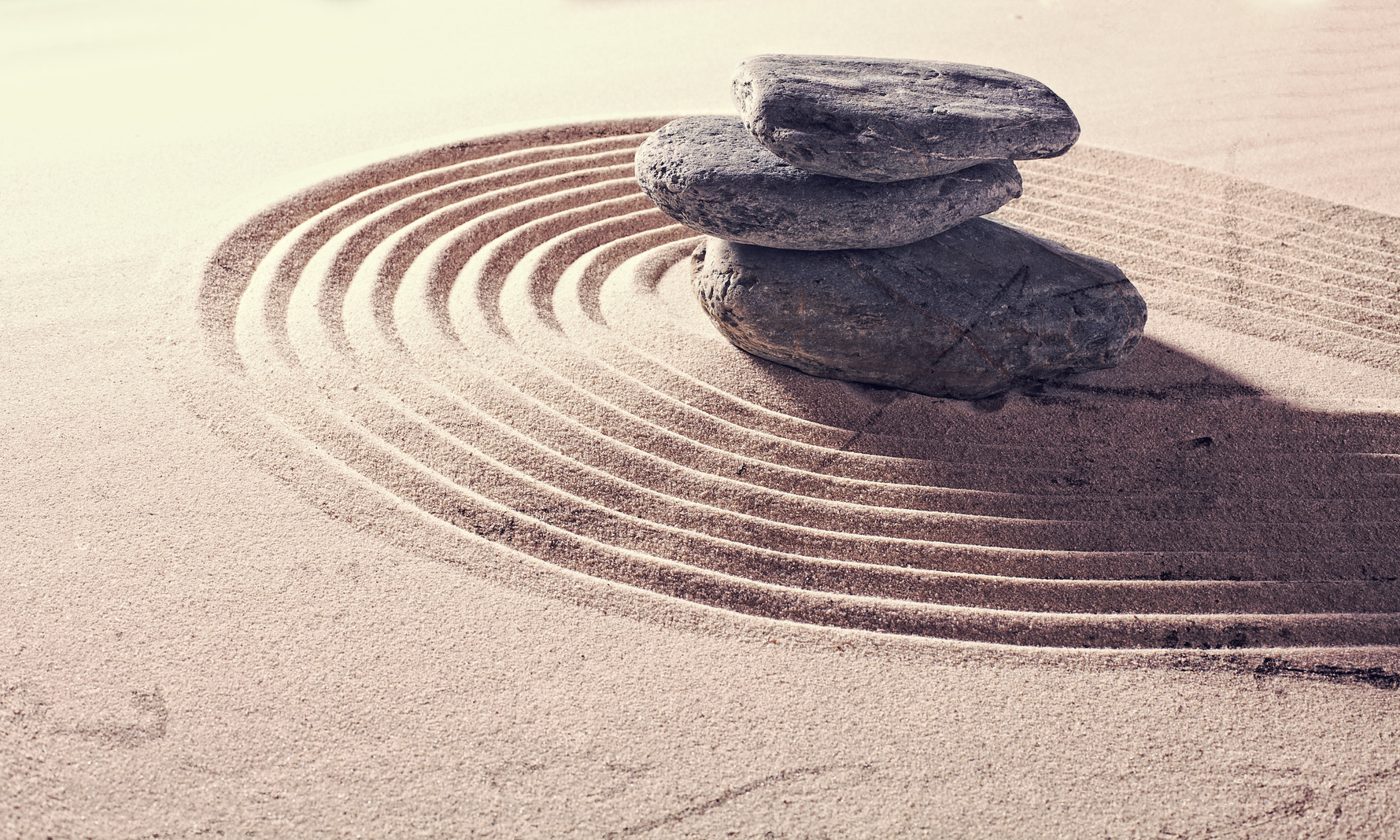 zen still life for spa and massage with sand and stones for relaxation and meditation with textured and contrast effects